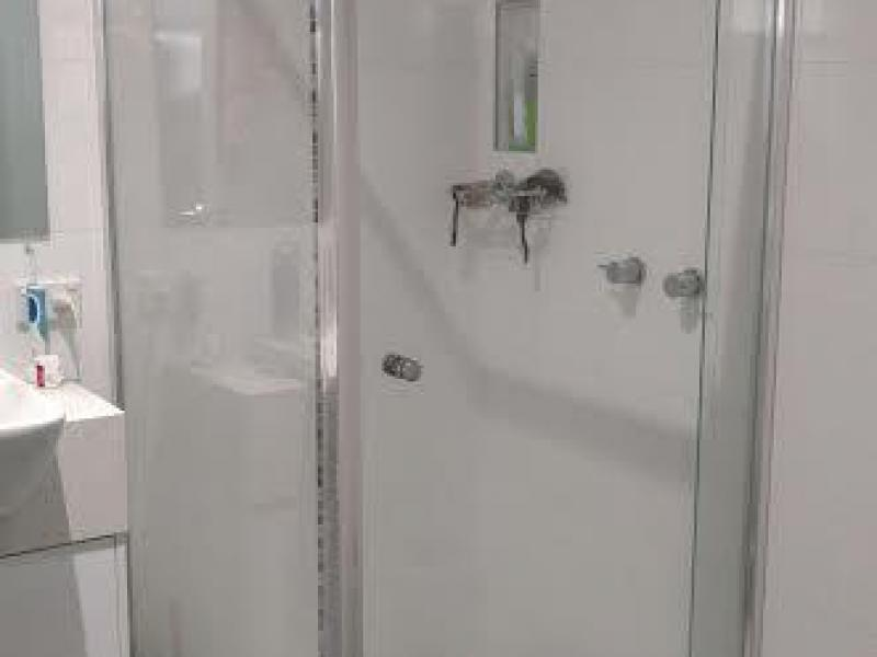 Bathroom with shower recess and bath