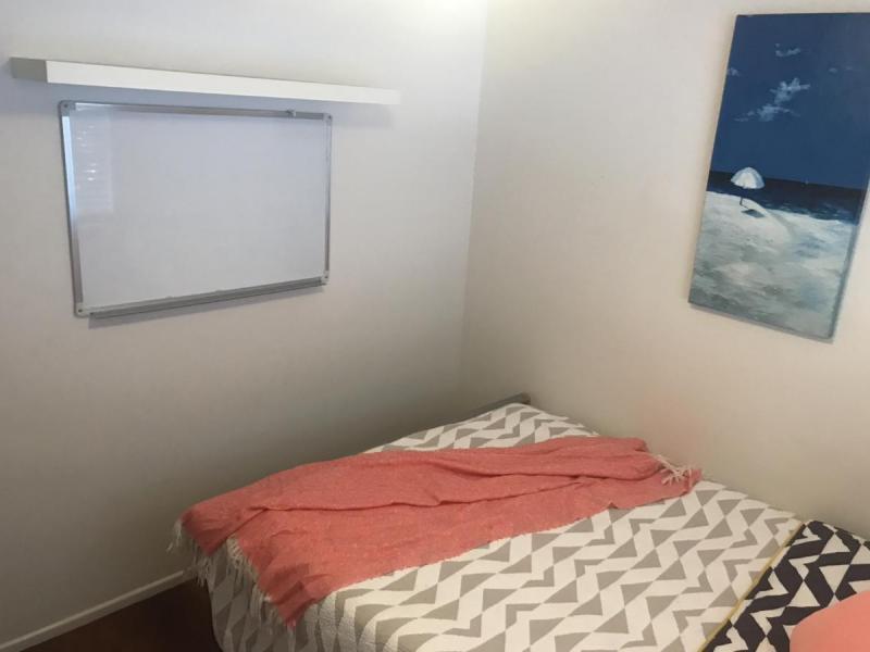 Bedroom - whiteboard and bookshelf