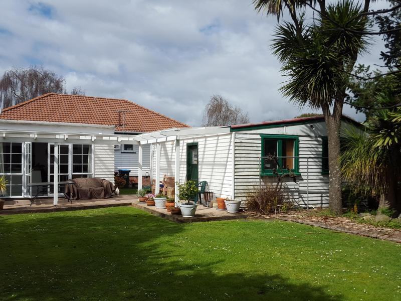 45 Avondale rd, back yard, very sunny and private. well kept lawn and gardens.