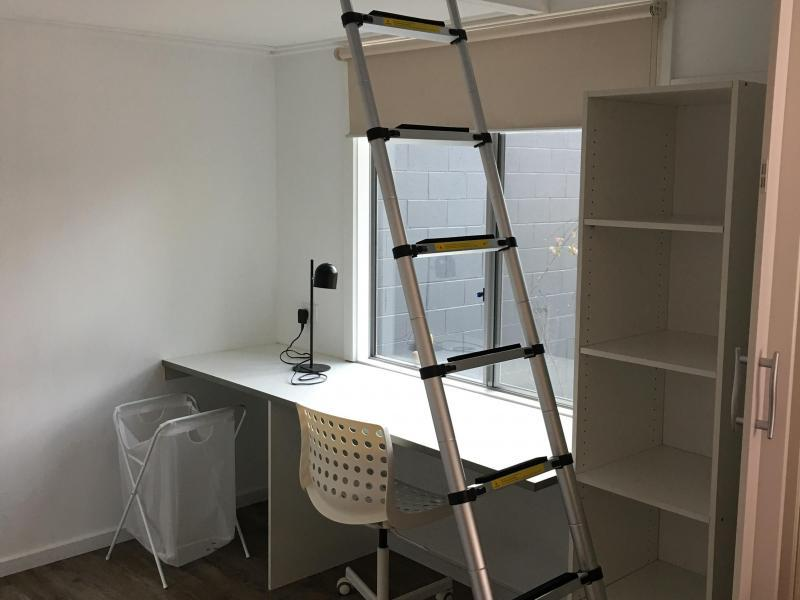 study room with loft bed