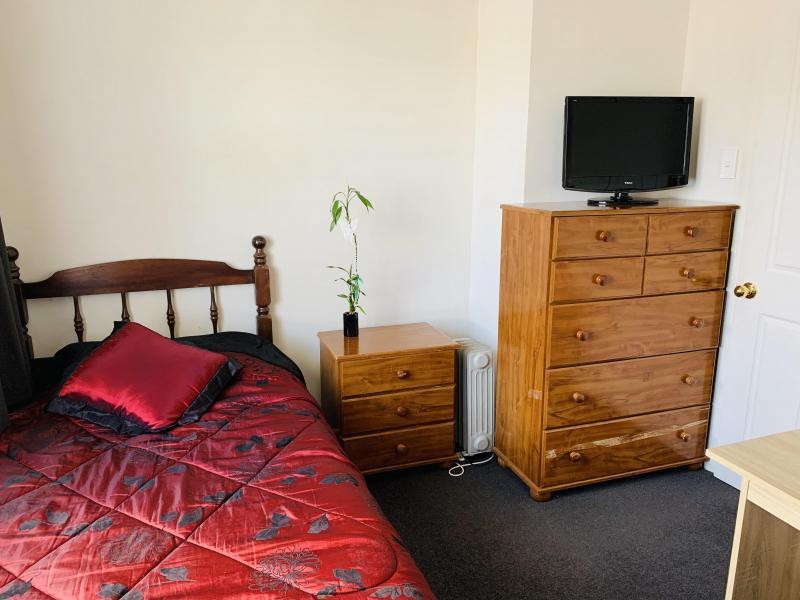 Single Bedroom - King single bed, drawers & wardrobe, heater in winter, fan in summer.