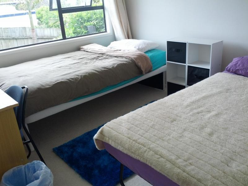 ROOM 2: 2 single beds + study desk + chair + Wardrobe + Bedside Cabinets. Very sunny.