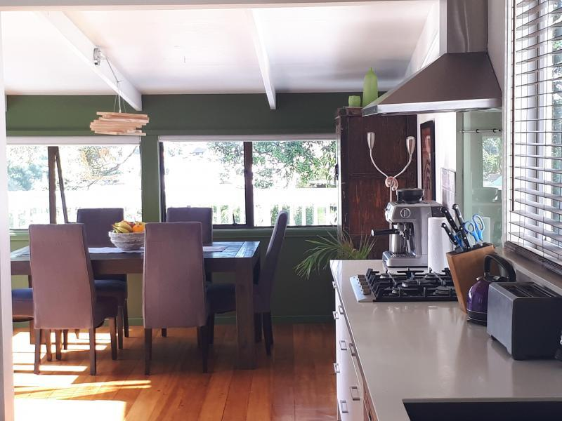 this is the kitchen and sunny dining area