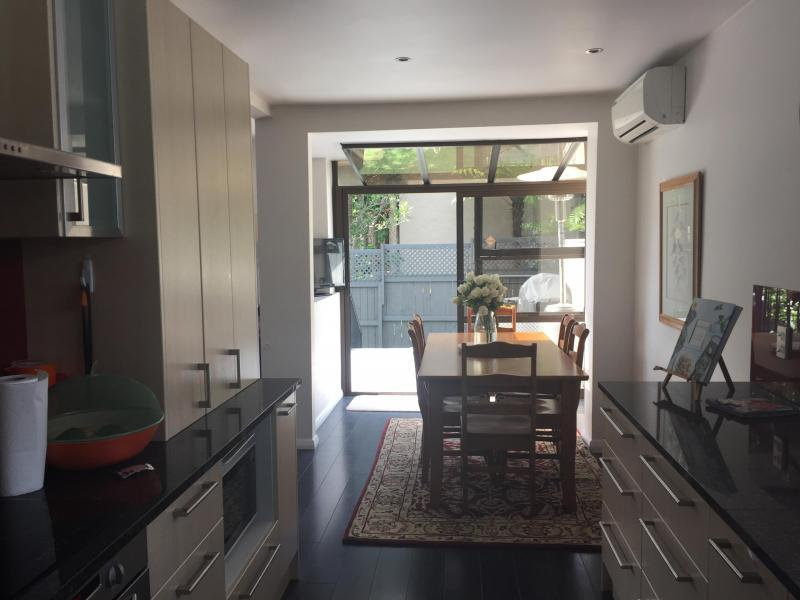 Another photo of kitchen with outside deck