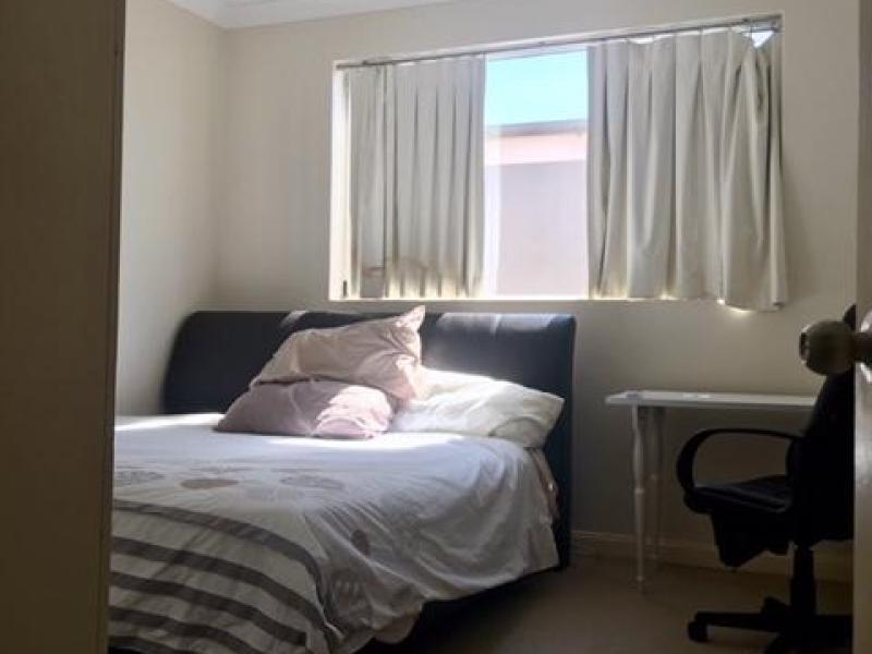 Bedroom 1 - Ceiling Fan,large screened windows, built in wardobe, king size bed, desk and more.