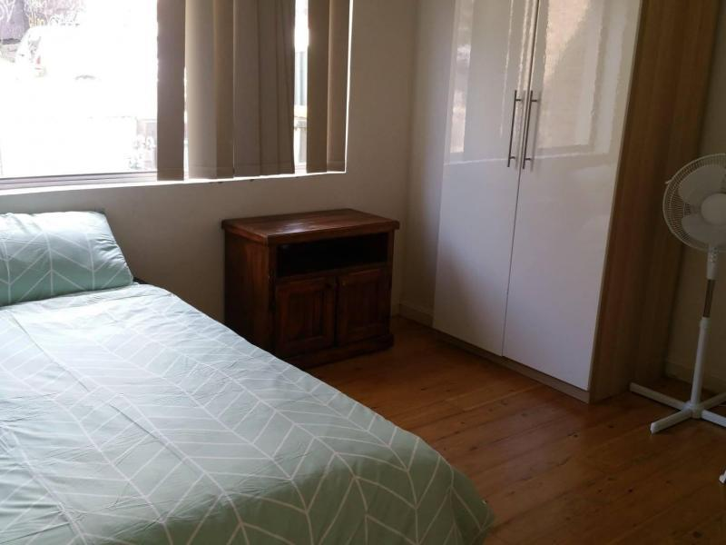 Single room with double bed, bedside table, study table and chair